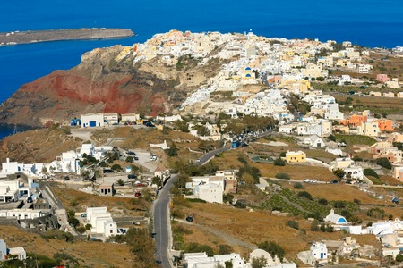 ia: Aerial view of Oia or Ia and Finikia on the island Santorini, white houses, windmills and church with blue domes, Greece