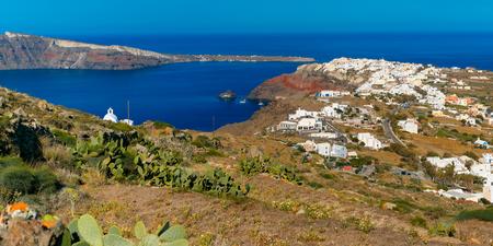 caldera: Aerial panoramic view of Oia or Ia and Finikia on the island Santorini, white houses, windmills and church with blue domes, Greece Stock Photo