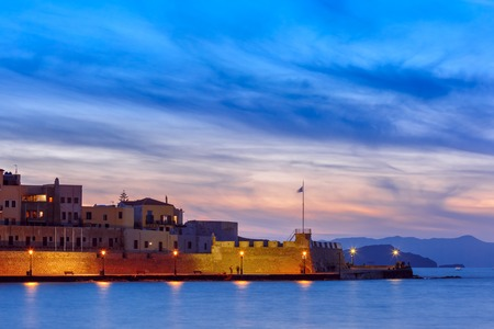 morning blue hour: Famouse venetian harbour waterfront of Chania at sunset, Crete, Greece