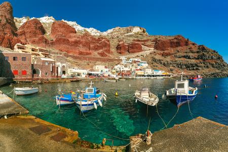 Fishing boats at Old port Amoudi of Oia village at Santorini island in Aegean sea, Greece Фото со стока