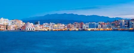 panoramic view: Panoramic view of Venetian quay of Chania with Kucuk Hasan Pasha Mosque during twilight blue hour, Crete, Greece Stock Photo