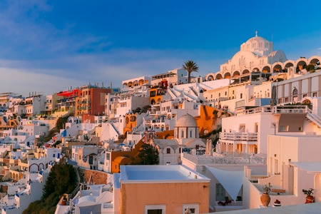 sea of houses: Fira, main town of the island Santorini, sea, white houses and church at sunset, Greece Stock Photo