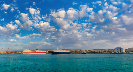passenger ships: Passenger ships in the sea port, loading, unloading cranes in cargo port of Heraklion, Crete, Greece. Panorama Stock Photo