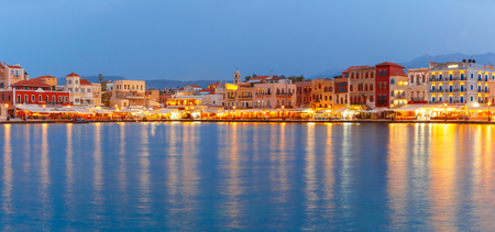 harbour: Picturesque panoramic view of old harbour and Venetian quay of Chania during twilight blue hour, Crete, Greece