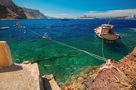 boat motor: Fishing Boat, motor boats and cruise liners in Mesa Gialos, Old Port of Fira, Santorini, in the sunny day, Greece. Stock Photo