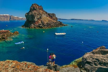 Tourists on the Armeni bay beach near Oia village at Santorini island in Aegean sea, Greece Stock Photo - 59875338
