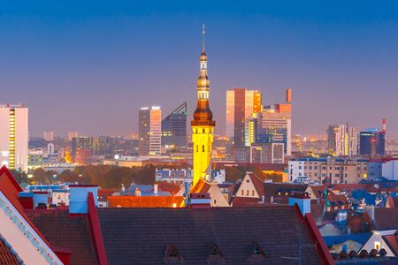 old town hall: Aerial cityscape with old town hall spire and modern office buildings skyscrapers in the background in the evening, Tallinn, Estonia