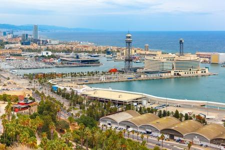 colom: Aerial view over Port Vell marina, Passeig de Colom, Barceloneta and Rambla de Mar in Barcelona, Catalonia, Spain