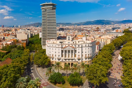 colom: Aerial view over La Rambla from Christopher Columbus monument, with quarters of El Raval in Barcelona, Catalonia, Spain