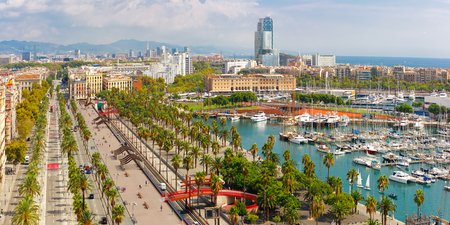 colom: Aerial panoramic view over Passeig de Colom or Columbus avenue, La Barceloneta and Port Vell marina from Christopher Columbus monument in Barcelona, Catalonia, Spain Stock Photo