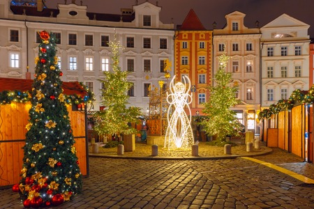tree decorations: Christmas tree and holiday decorations in the Old Town in the magical city of Prague at night, Czech Republic