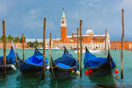 saint mark square: Gondolas moored by Saint Mark square with San Giorgio di Maggiore church in the background in Venice lagoon after the storm, Italia Stock Photo