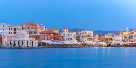 blue hour: Panoramic view of Venetian quay of Chania with Kucuk Hasan Pasha Mosque during twilight blue hour, Crete, Greece Stock Photo