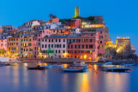 fishing village: Night fishing village Vernazza with lookout tower of Doria Castle to protect the village from pirates, Five lands, Cinque Terre National Park, Liguria, Italy.