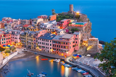 fishing village: Aerial Night fishing village Vernazza with lookout tower of Doria Castle to protect the village from pirates, Five lands, Cinque Terre National Park, Liguria, Italy.