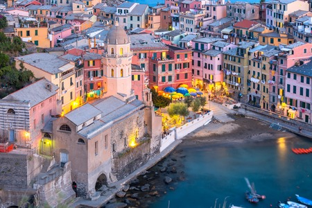 vernazza: Aerial view of Vernazza fishing village with Santa Margherita di Antiochia Church at sunset, seascape in Five lands, Cinque Terre National Park, Liguria, Italy.