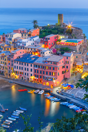 vernazza: Aerial night view of Vernazza fishing village, seascape in Five lands, Cinque Terre National Park, Liguria, Italy.