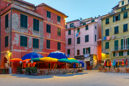 fishing village: Night fishing village Vernazza with colorful umbrellas and tables on town square, Five lands, Cinque Terre National Park, Liguria, Italy.