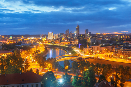 Aerial panoramic cityscape with skyscrapers of New Center of Vilnius from Gediminas Tower at night, Lithuania, Baltic states.