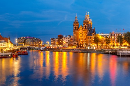 city view: Night panoramic city view of Amsterdam canal, bridge and Basilica of Saint Nicholas, Holland, Netherlands. Long exposure.