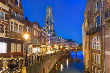 tallest bridge: Dom Tower, bridge and canal Oudegracht in the night colorful illuminations in the blue hour, Utrecht, Netherlands