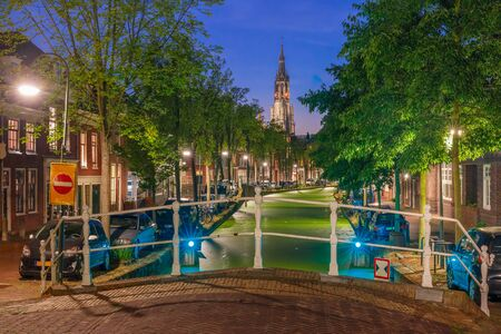 protestant: Night canal and Gothic Protestant Nieuwe Kerk church in Delft, Holland, Netherlands Stock Photo