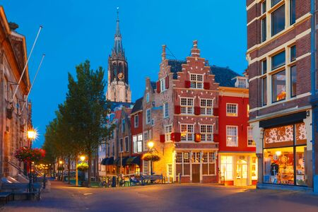 dutch canal house: Night canal, typical dutch house and Gothic Protestant Nieuwe Kerk, New church, in Delft, Holland, Netherlands Stock Photo
