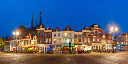 Panorama of typical Dutch houses on the Markt square in the center of the old city at night, Delft, Holland, Netherlands Stock Photo