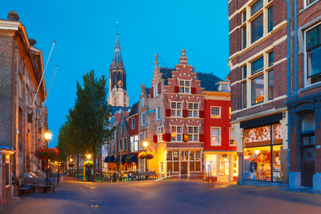 Night canal, typical dutch house and Gothic Protestant Nieuwe Kerk, New church, in Delft, Holland, Netherlands Stock Photo