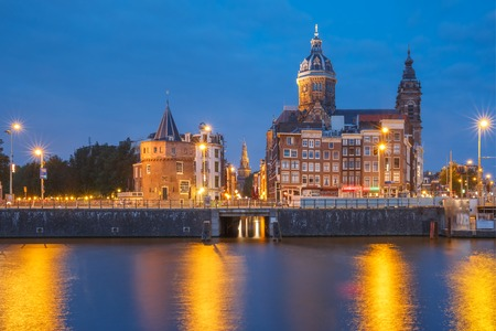 colourful lightings: Night panoramic city view of Amsterdam canal, bridge and Basilica of Saint Nicholas, Holland, Netherlands. Long exposure.