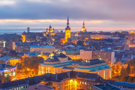 saint nicholas: Aerial cityscape with Medieval Old Town illuminated at sunset with Saint Nicholas Church, Cathedral Church of Saint Mary and Alexander Nevsky Cathedral in Tallinn, Estonia Stock Photo