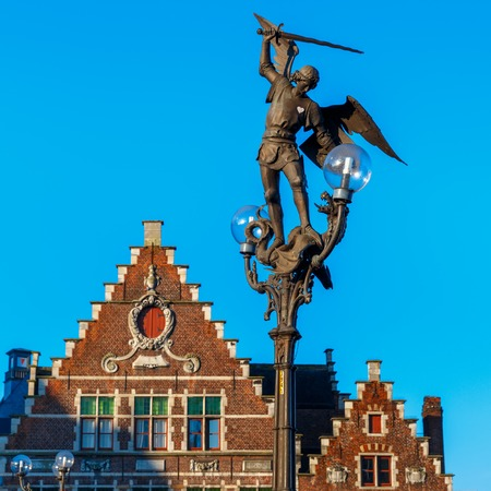 belgique: Statue of Archangel Michael, hitting with his spear the devil in the guise of a dragon on the bridge of Saint Michael in Ghent, Belgium