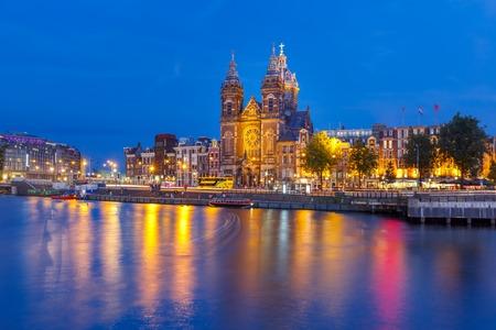 saint nicolas: Night panoramic city view of Amsterdam canal, bridge and Basilica of Saint Nicholas, Holland, Netherlands. Long exposure.