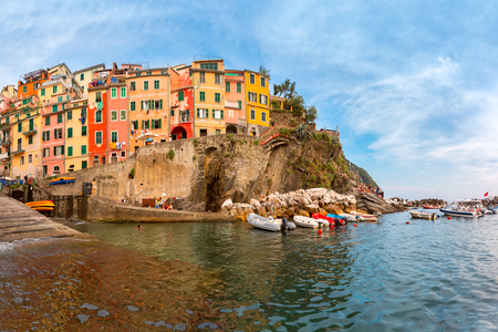 Riomaggiore fishing village in Five lands, Cinque Terre National Park in the evening, Liguria, Italy.