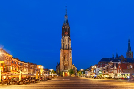 protestant: Gothic Protestant Nieuwe Kerk, New church on Markt square in the center of the old city at night, Delft, Holland, Netherlands Stock Photo