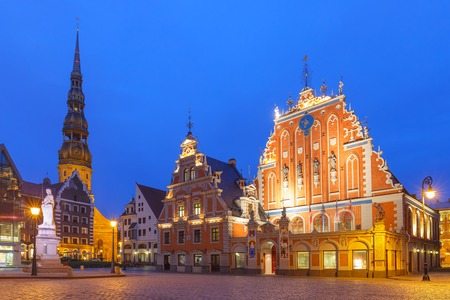 City Hall Square with House of the Blackheads and Saint Peter church in Old Town of Riga at night, Latvia Stock Photo