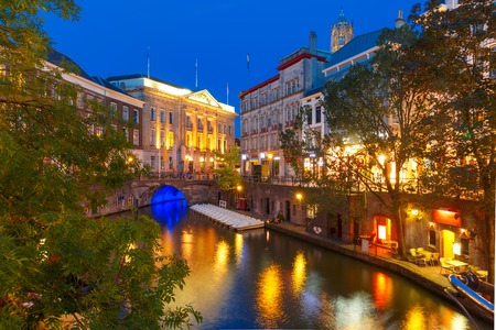 Canal Oudegracht and bridge in the colorful illuminations at night, Utrecht, Netherlands