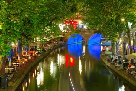 Canal Oudegracht in the night colorful illuminations in the blue hour, Utrecht, Netherlands Stock Photo