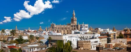seville: Panorama of Famous Bell Tower named Giralda in landmark catholic Cathedral Saint Mary of the See, aerial view from the Torre Del Oro, Seville, Andalusia, Spain