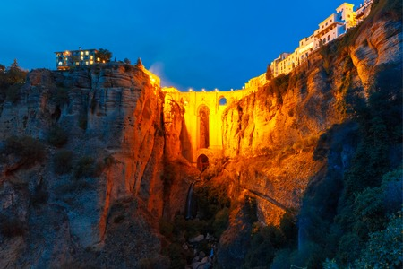 Puente Nuevo, New Bridge, at night illuminated over the Tajo Gorge in Ronda, Andalusia, Spain