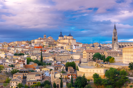 mancha: Old city of Toledo with Primate Cathedral of Saint Mary, churches of San Ildelfonso, San Roman and Santo Tome at sunset, Castilla La Mancha, Spain. Stock Photo