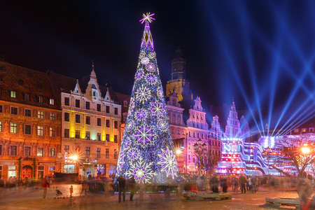 Christmas tree and light laser show on Market Square at christmas night in Wroclaw, Poland Stock Photo