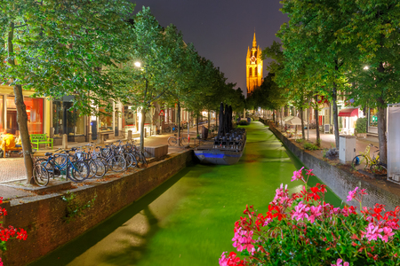 protestant: Oude Delft canal and leaning tower of Gothic Protestant Oude Kerk church at night, Delft, Holland, Netherlands