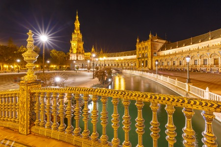 Patterned fence of the bridge on the Spain Square or Plaza de Espana in Seville at night, Andalusia, Spain Stock Photo