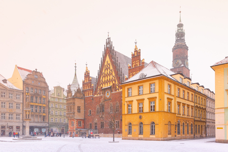 City hall and colorful houses on Market Square in the winter sunny morning in Wroclaw, Poland Stock Photo
