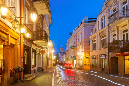 eventide: Gediminas Tower or Upper Castle as viewed from Pilies Street at night, Old Town of Vilnius, Lithuania, Baltic states.