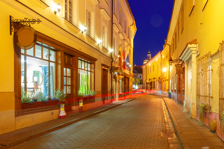 eventide: Picturesque Street and luminous track from the car at night in Old Town of Vilnius, Lithuania, Baltic states. Stock Photo