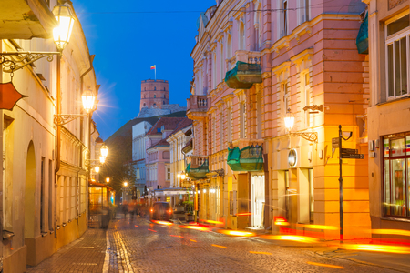 eventide: Gediminas Tower or Upper Castle as viewed from Pilies Street with luminous track from the car at night, Old Town of Vilnius, Lithuania, Baltic states.