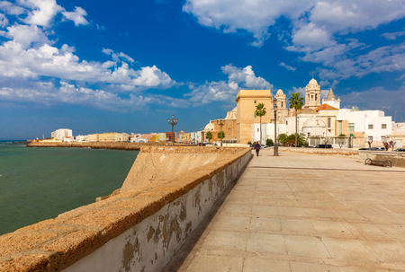 santa cruz: Seafront and Cathedral de Santa Cruz in the morning in Cadiz, Andalusia, Spain