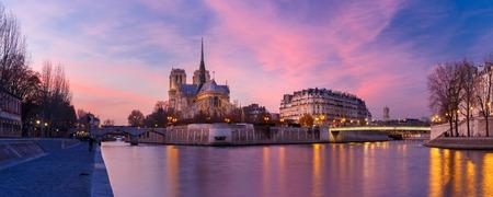 notre dame de paris: Picturesque grandiose sunset over Cathedral of Notre Dame de Paris, France. Panorama Stock Photo